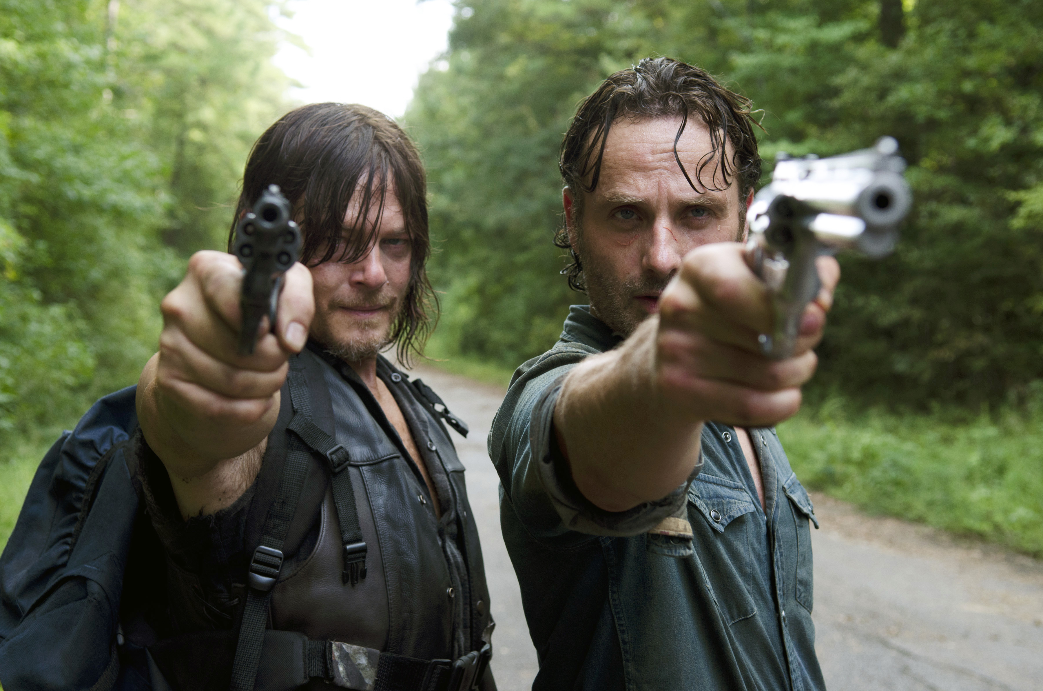 Andrew Lincoln as Rick Grimes and Norman Reedus as Daryl Dixon - The Walking Dead